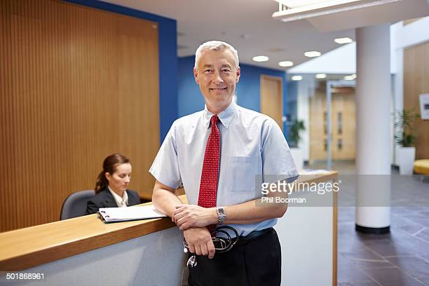Doctor standing in hospital waiting room