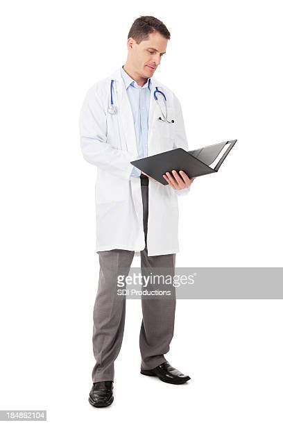 Doctor standing reading notes,  Isolated on White