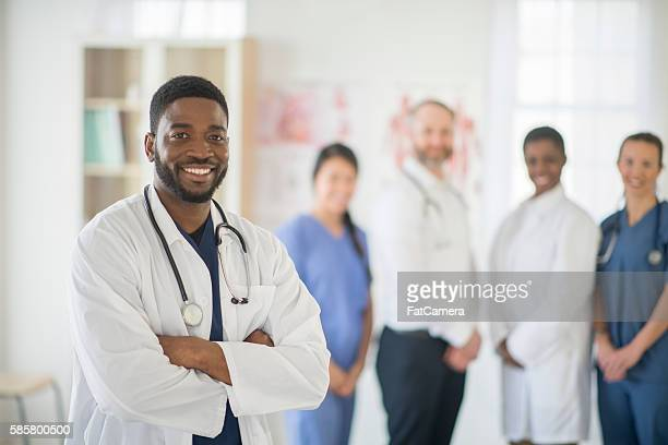 Doctor Standing with His Medical Team