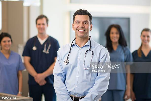 Doctor Standing with His Team of Nurses