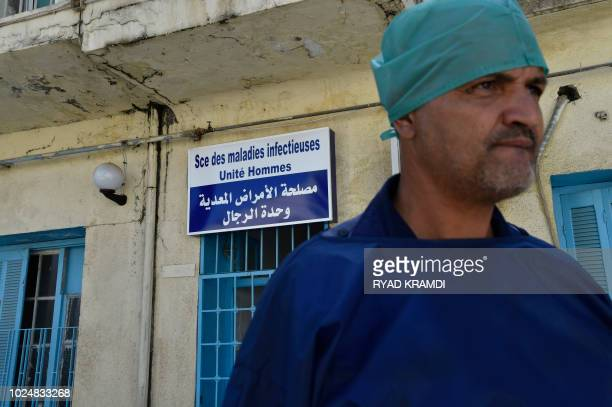 A doctor stands outside a hospital in the Algerian town of Boufarik as the country faces a cholera outbreak on August 28 2018