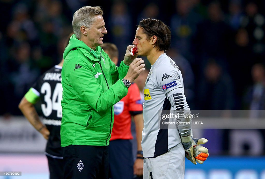 Doctor Stefan Hertl treats Yann Sommer of Moenchengladbach during the UEFA Champions League Group D match between VfL Borussia Monchengladbach and Manchester City FC on September 30, 2015 in Moenchengladbach, Germany.