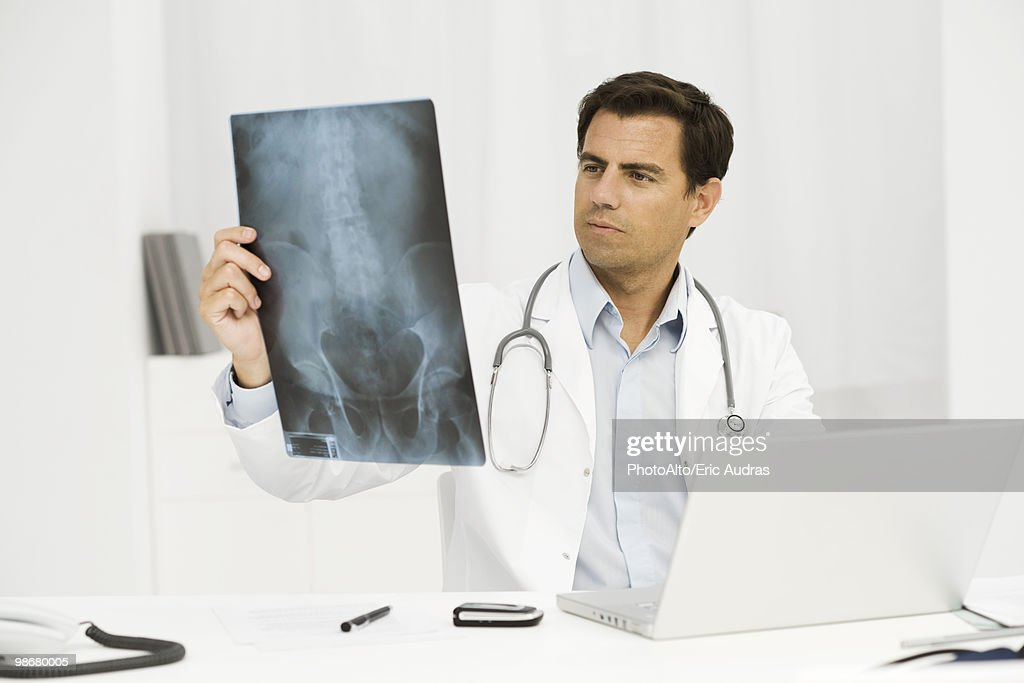 Doctor studying x-ray : Stock Photo