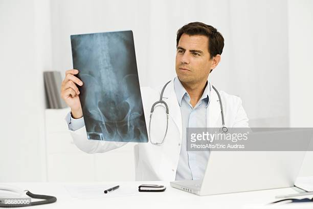 Doctor studying x-ray