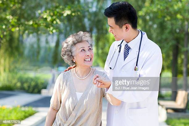 doctor taking care of patient - tree man syndrome stock photos and pictures