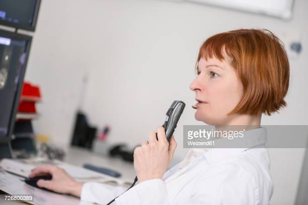 Doctor talking into microphone