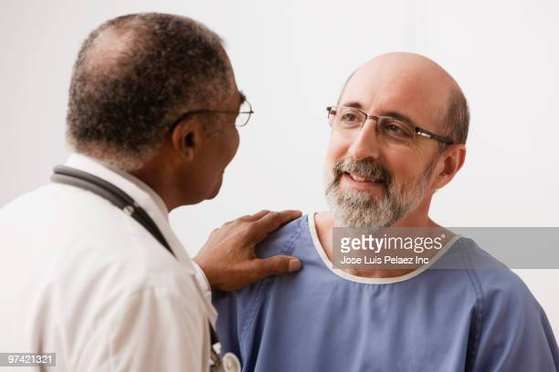 Doctor talking to Hispanic patient