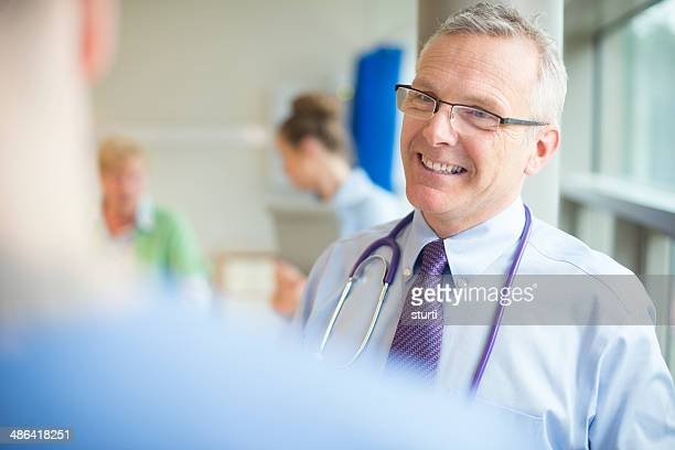 doctor talking to medical staff