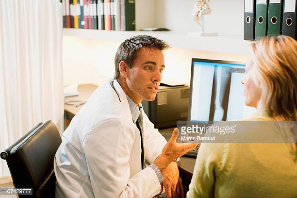 Doctor talking to patient in doctors office