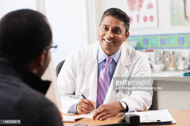 doctor talking to patient in doctor's office - prescription stock pictures, royalty-free photos & images