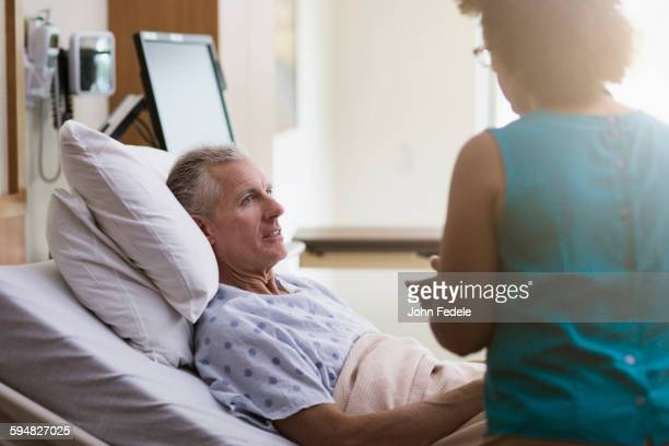 Doctor talking to patient in hotel room