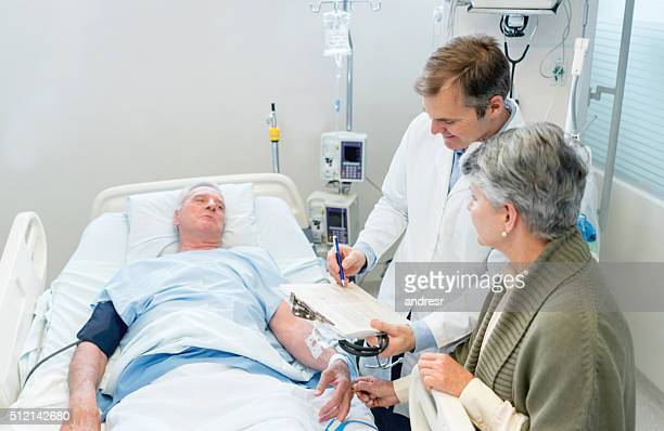 Doctor talking to patient's family at the hospital