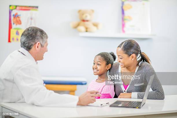 Doctor Talking to the Patient and Her Mother