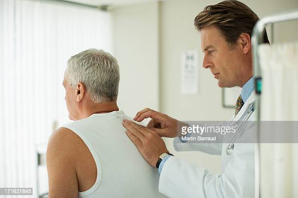 Doctor tapping on patient's back