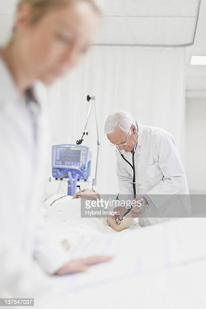 Doctor tending to patient in hospital