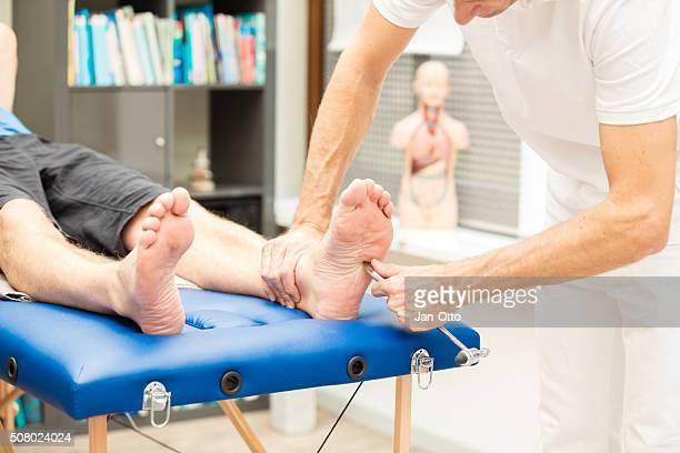 Doctor testing Babinski reflex