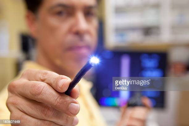 Doctor testing lighted probe used for endoscopy testing