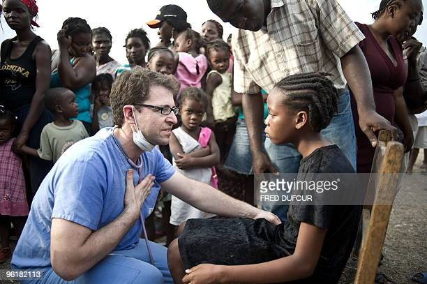 A doctor treats a child at a temporary clinic in January 25 2010 Top world officials gathered in Montreal today for emergency talks to hash out plans...