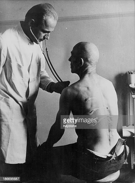 A doctor treats a Danish man who had been in a concentration camp for ten years during World War Two Great Britain circa 19441945