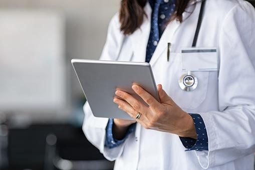 Doctor using digital tablet 1189302646