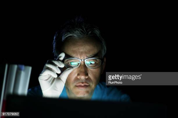 doctor using laptop in office - scientificsubjects stock pictures, royalty-free photos & images