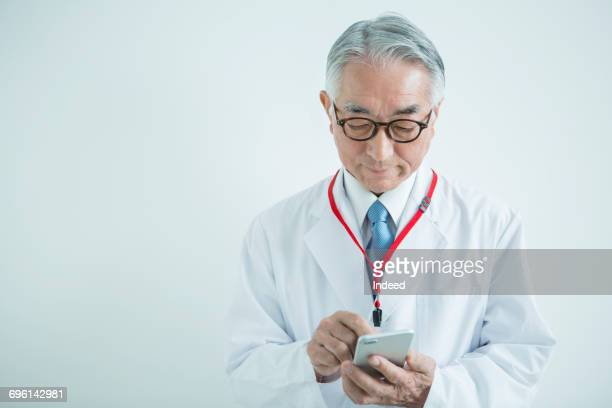 Doctor using smart phone