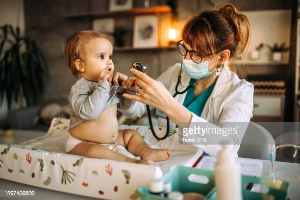 doctor using stethoscope for medical examination - baby changing mat stock pictures, royalty-free photos & images