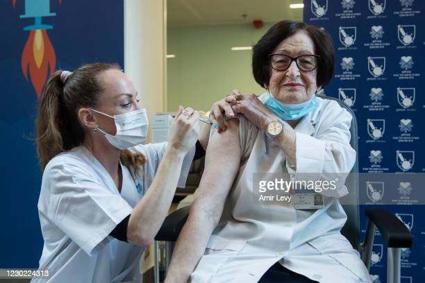 Doctor Verona Radosh is vaccinated by a medical worker against Coronavirus disease at Tel Aviv Sourasky Medical Center as Israel starts the COVID 19...