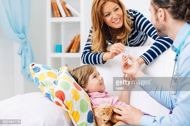 doctor visit little patient at home. - tonsil stock photos and pictures