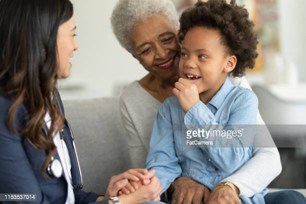 doctor visits grandma and child - house call stock pictures, royalty-free photos & images