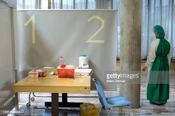 Doctor waits in the vaccination centre for the next patient to arrive on February 11, 2021 in Kranj, Slovenia. Slovenia plans to vaccinate 5% of its...