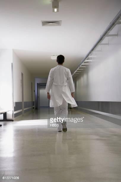 Doctor walking down corridor