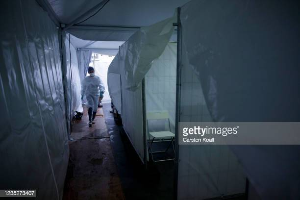Doctor walks between between cabins at a temporary vaccination center, where a voucher for a doner kebab is issued after the vaccination, on the...
