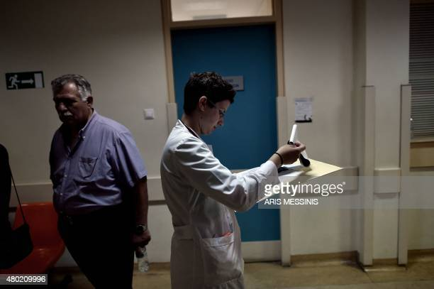 A doctor walks in a corridor in an Athens hospital on July 8 2015 With expectations of a Greek exit from the eurozone gathering pace health officials...
