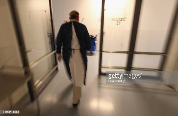 A doctor walks through the Nephrology Unit where patients suffering from hemolyticuremic syndrome a complication that can lead to kidney failure...