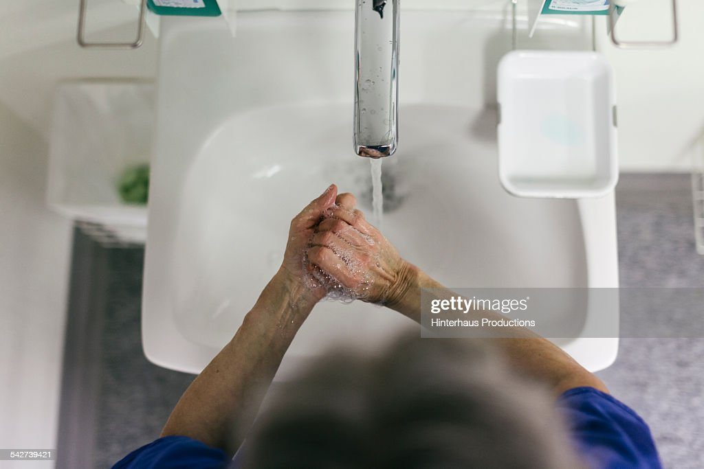 Doctor Washing Hands Before Surgery Stock Photo - Getty Images