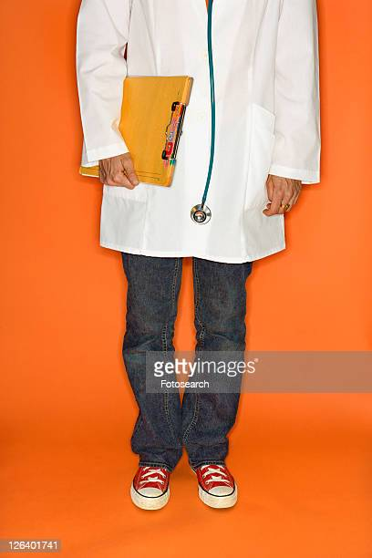 doctor wearing jeans and sneakers. - bow legged stock photos and pictures