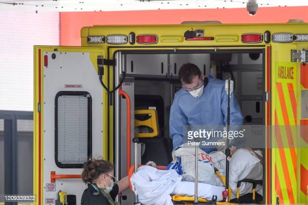 A doctor wearing protective equipment is seen unloading a patient outside St Thomas' Hospital on April 7 2020 in London England Prime Minister Boris...