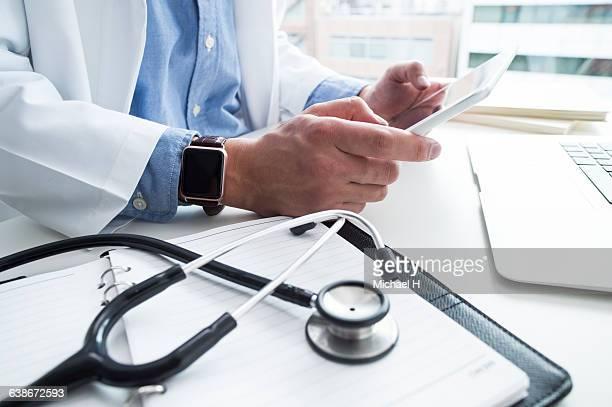 Doctor wearing smartwatch.
