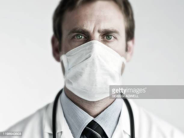 doctor wearing surgical mask - virus stock pictures, royalty-free photos & images