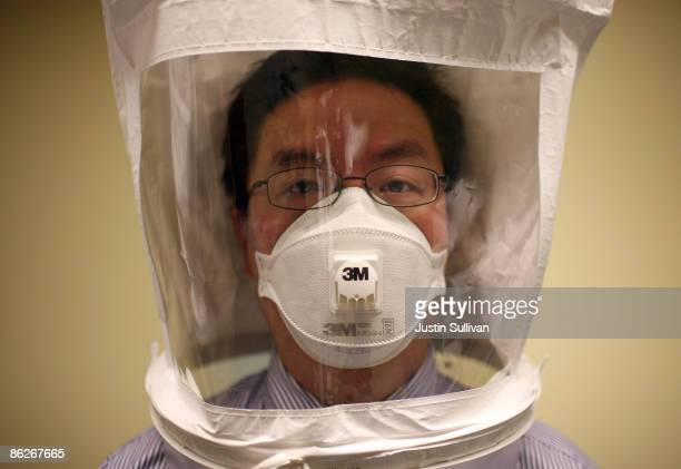 Doctor wears a hood as he tests the seal of an N95 respiratory maske during a training at the La Clinica San Antonio Neighborhood Health Center April...