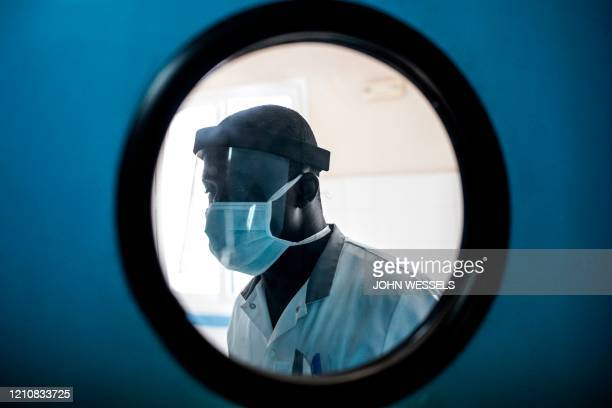 Doctor wears a protective mask inside the emergency ward in Pikine Hospital in Dakar on April 23, 2020. - As COVID-19 coronavirus cases slowly...