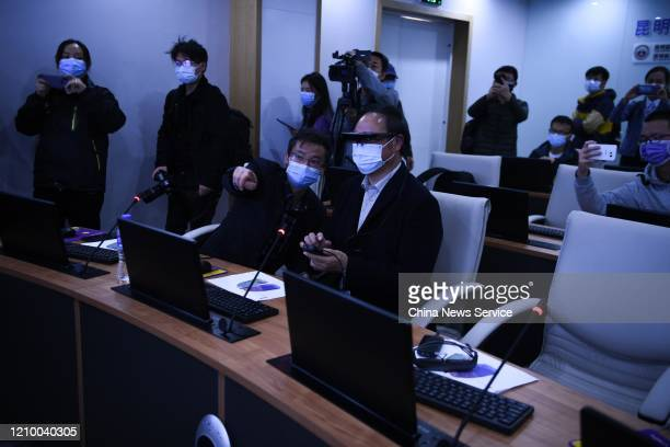 Doctor wears an augmented reality headset during a 5G long-distance consultation at the First Affiliated Hospital of Kunming Medical University on...