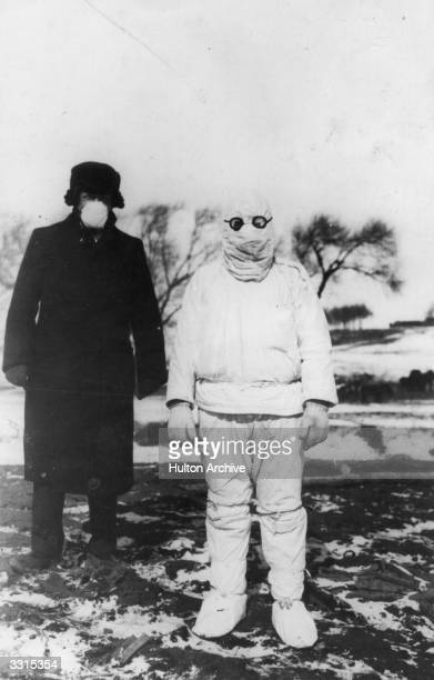 Doctor wears protective clothing during an outbreak of plague in Manchuria.