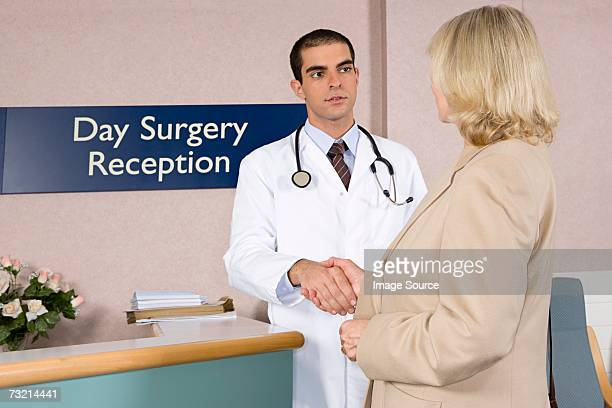 doctor welcoming patient - outpatient care stock pictures, royalty-free photos & images