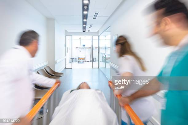 Doctor wheeling patient