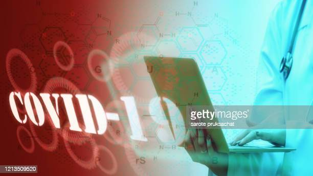 doctor while working with a laptop  with futuristic  hud screen tablet . coronavirus disease named covid-19. - coronavirus doctor stock pictures, royalty-free photos & images