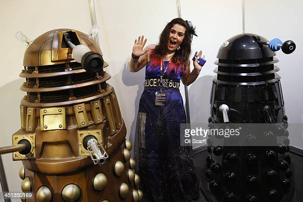 Doctor Who fan dressed as the TARDIS poses for a photograph with Dalek models at the 'Doctor Who 50th Celebration' event in the ExCeL centre on...