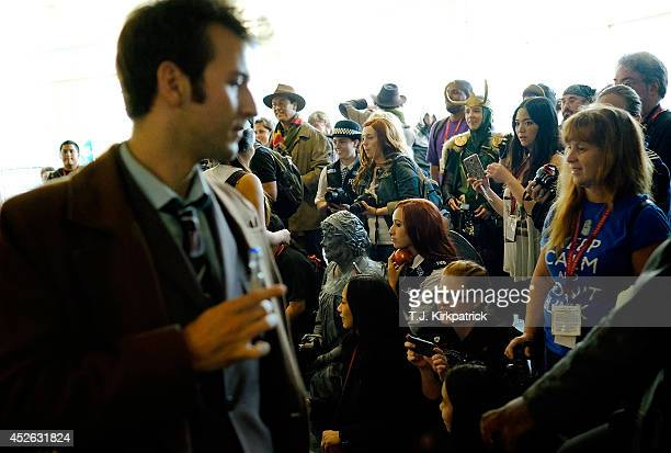 Doctor Who fans both in and out of costume gather for group photos during the 45th annual San Diego ComicCon on July 24 2014 in San Diego California...