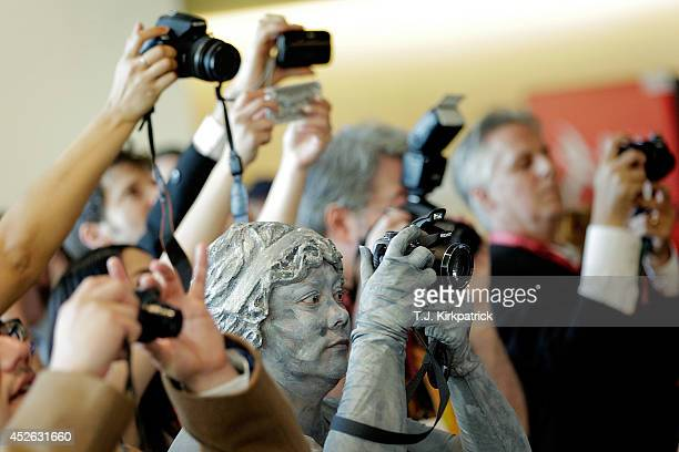 Doctor Who fans including a stone angel from the series snap photos during the 45th annual San Diego ComicCon on July 24 2014 in San Diego California...